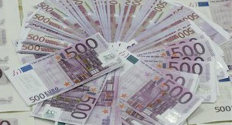 Евро упал до нового минимума на слухах  о намерениях Меркель