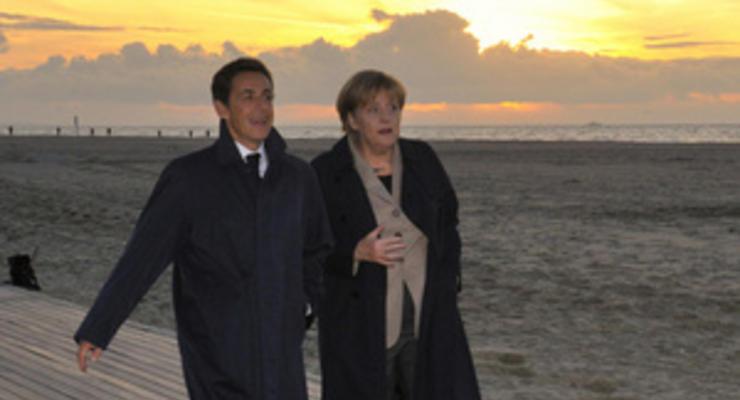 Меркель и Саркози требуют ускорить решение долгового кризиса в Греции