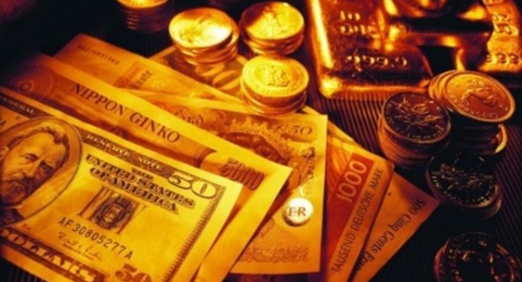 Золото на COMEX 17 января опустилось ниже $1240 за унцию