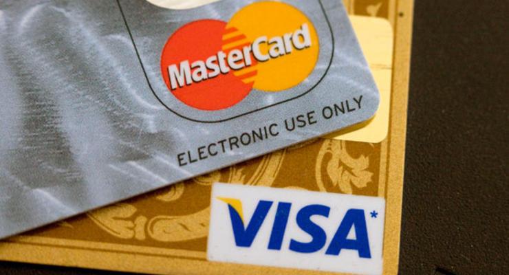 Visa и MasterCard перестали обслуживать клиентов банка Россия