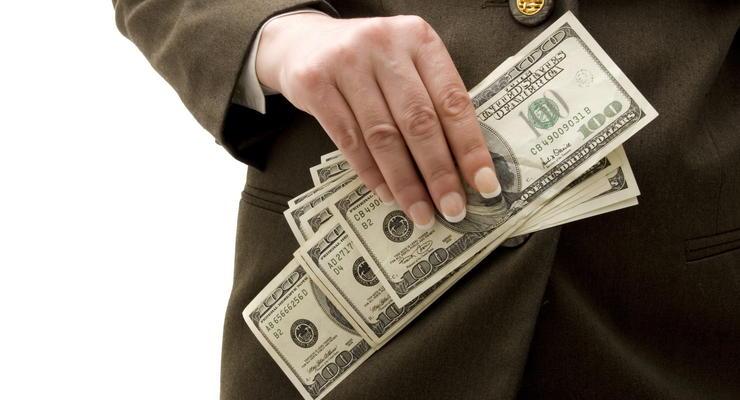 Доллар снизился на открытии межбанка