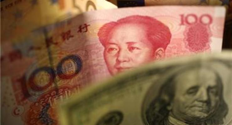 Банк Китая снова опустил курс юаня