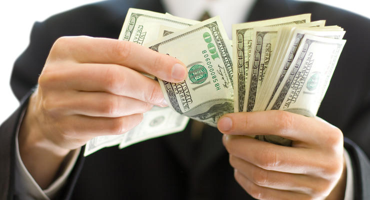МВФ считает курс доллара США завышенным
